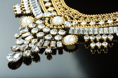 white gold: metal feminine necklace. on black  background. Stock Photo