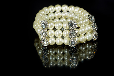 bracelet of pearls on a black background photo