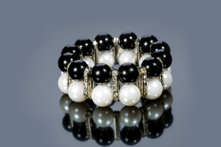 bracelet of pearls on a gray background photo