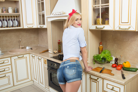 girl in the kitchen in short shorts