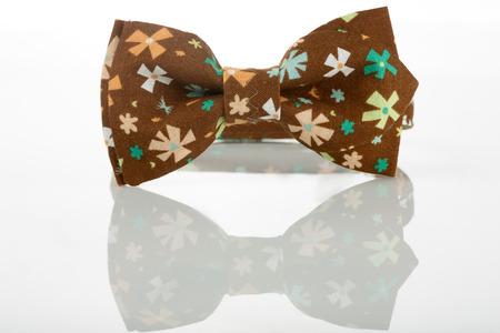 floret: Brown bow tie on a white background. floret