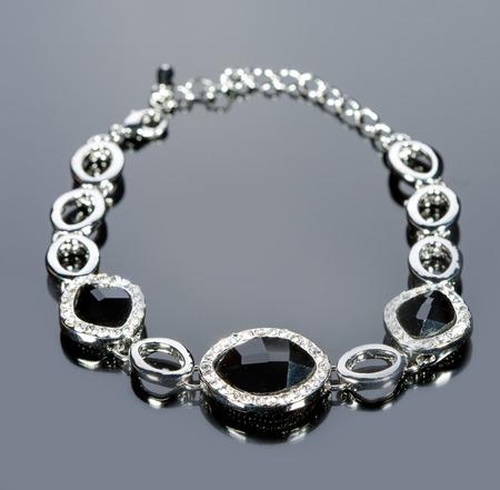 beautiful bracelet on gray background. photo