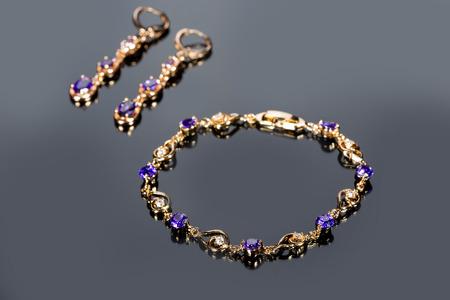 gold bracelet on gray background. photo