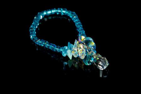 beautiful blue plastic bracelet on black background. photo