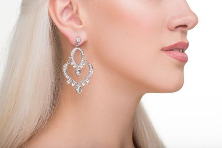 platinum hair: beautiful girl with long white hair and earrings. fashionable photo. portrait. Fashion photo