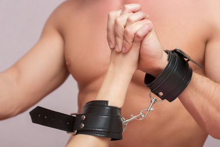 romance sex: sexy pair of lovers handcuffed. sex Toys. having sex Stock Photo