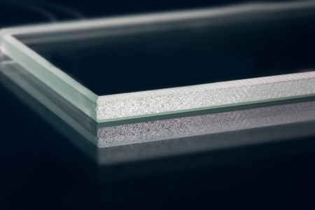 brink: Glass roving fibre for pultrision process. Window fiberglass profile manufacturing. Plate glass, machined edge Stock Photo