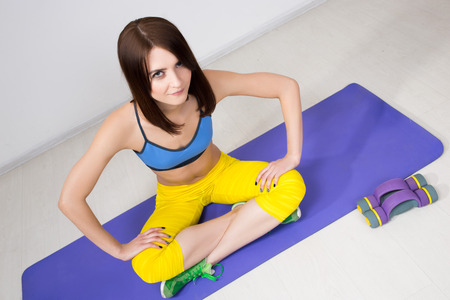 happy cutie athletic girl ,  execute exercise on muscles belly Stock Photo