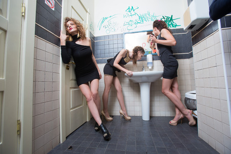 liquor girl: drunk girl in toilet bars. beautiful women in evening dresses in alcoholic intoxication