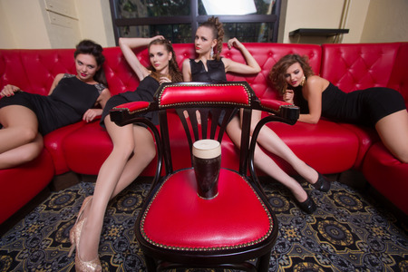 clang: beautiful girls lie on the couch for a glass of beer