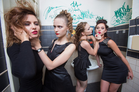 blinder: drunk girl in toilet bars. beautiful women in evening dresses in alcoholic intoxication