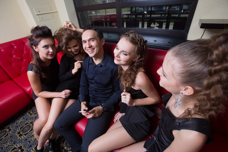 wanting: Portrait of sexy lovelace man surrounded by hot women wanting of proposal from him