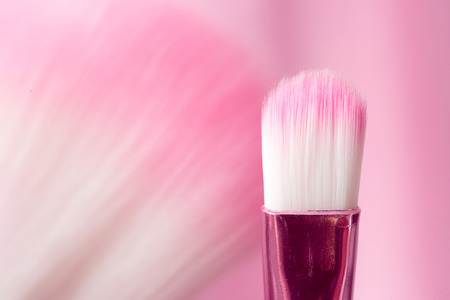 brush in: pink professional cosmetic brush in bright background