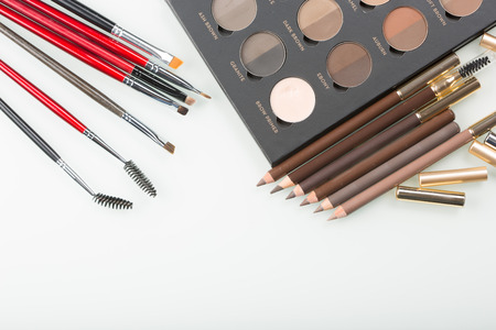 eyebrow: shadows eye and eyebrow set on table. eyebrow pencils