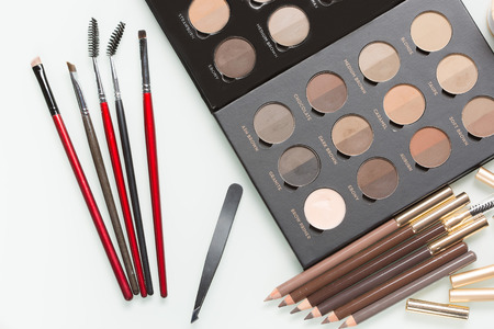 bridal salon: Eye shadows of different colors and make-up brushes. eyebrows Stock Photo