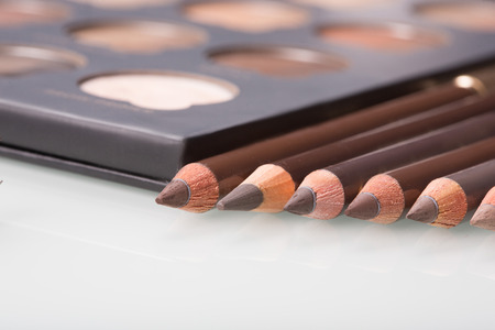 shadows eye and eyebrow set on table. eyebrow pencils