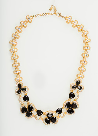 diamante: Necklace with black pearls on a white background Stock Photo