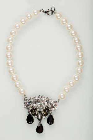 pearl necklace: pearl necklace with black stones on a white background