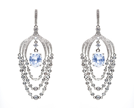 lapis: earrings with blue stones on the white background Stock Photo