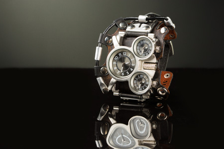 human wrist: unusual watches. several alternatives dials. wide leather bracelet