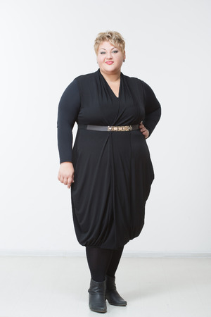 Fat Woman In A Beautiful Dress Light Background