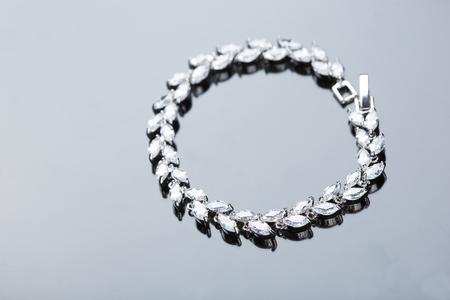 karat: Jewelry diamond bracelet on a gray background