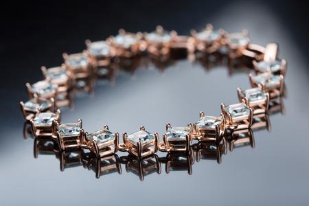 silver jewelry: Jewelry diamond bracelet on a gray background