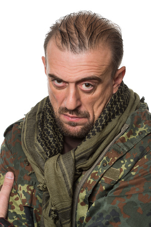 scary man: adult scary man in a camouflage jacket. a dangerous person. Neck scarf Stock Photo