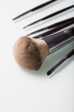 thickness: Makeup Brushes of different thickness on white  background