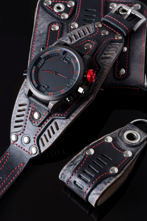key ring: accessory kit. biker watch, wallet and key ring. on black background Stock Photo