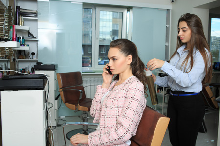 haircutter: Young sexy girl make hairstyle in a beauty salon