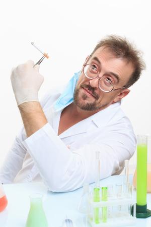 chemist: Crazy chemist smokes a cigarette. laboratory bench