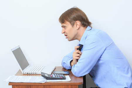disgruntled: disgruntled manager at his desk. on a light background