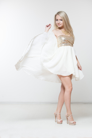 beautiful dress: beautiful young girl in flying white dress.