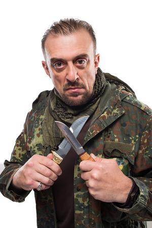 infantryman: adult man in soldier uniform holding knife