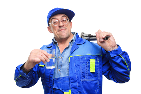 drunkenness: adult drunk mechanic working with glass of alcohol. white background