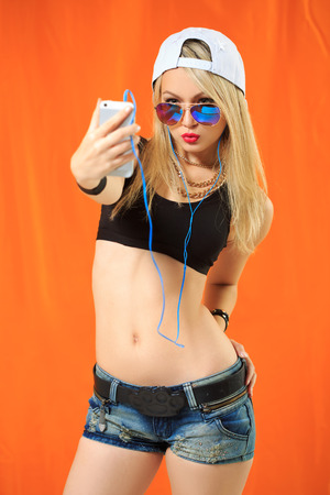 hip hop girl: sexy hip hop girl photographed themselves on the phone and listening to music