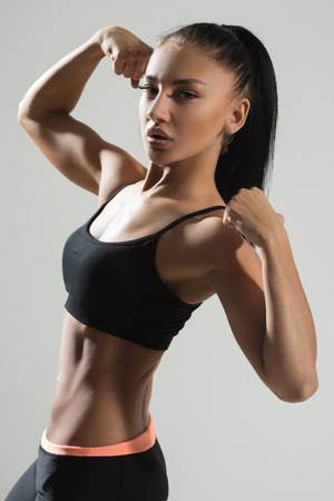 athletic body: attractive fitness woman, trained female body, lifestyle portrait, caucasian model. long hair Stock Photo