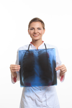 rib cage: doctor compares the rib cage X-ray. White background