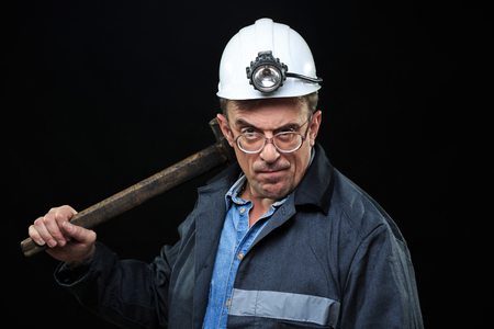 coal miner: Man with Coal Miner Hat and Safety Clothing, Black Background Stock Photo