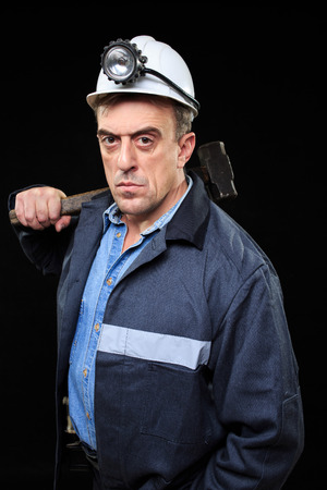 the miner: Man with Coal Miner Hat and Safety Clothing, Black Background Stock Photo