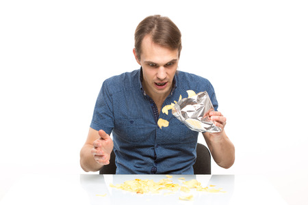 messily: young people scattered potato chips on the table