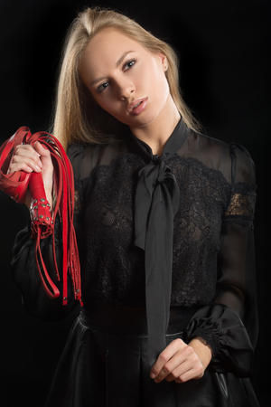 blinder: portrait of a girl with red leather whip