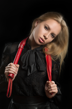 portrait of a girl with red leather whip