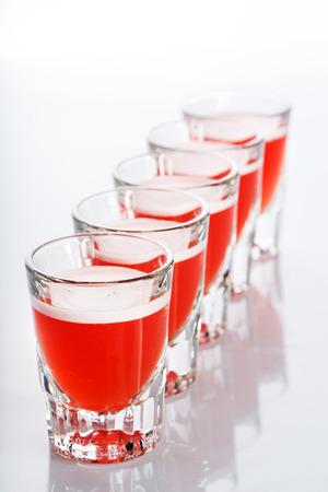 shot glasses: Beautiful shot glasses back lit on white background