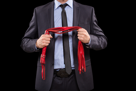 a man in a business suit with chained hands. handcuffs for sex games