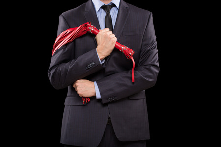 sex toys: a man in a business suit with chained hands. handcuffs for sex games