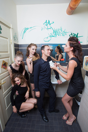 drunk girl: drunk girl in toilet bars. beautiful women in evening dresses in alcoholic intoxication