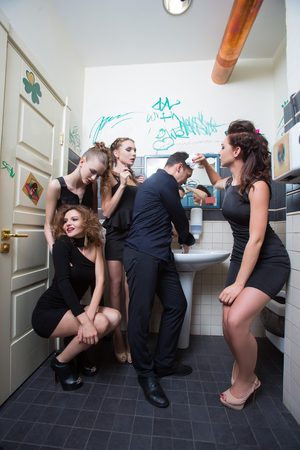 boozer: drunk girl in toilet bars. beautiful women in evening dresses in alcoholic intoxication