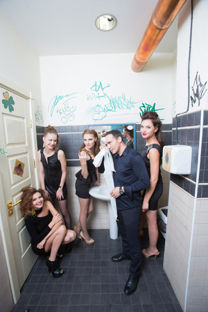 intoxication: drunk girl in toilet bars. beautiful women in evening dresses in alcoholic intoxication
